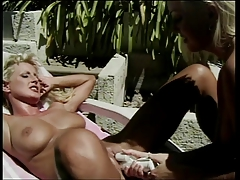 Two sexy blondes enjoying their time as they make out outdoors