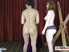 2 girls play a strip game of roll the dice