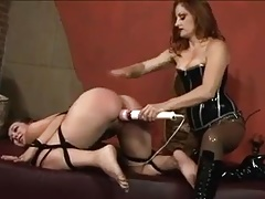 Mistress dominating and fucking her slave girl
